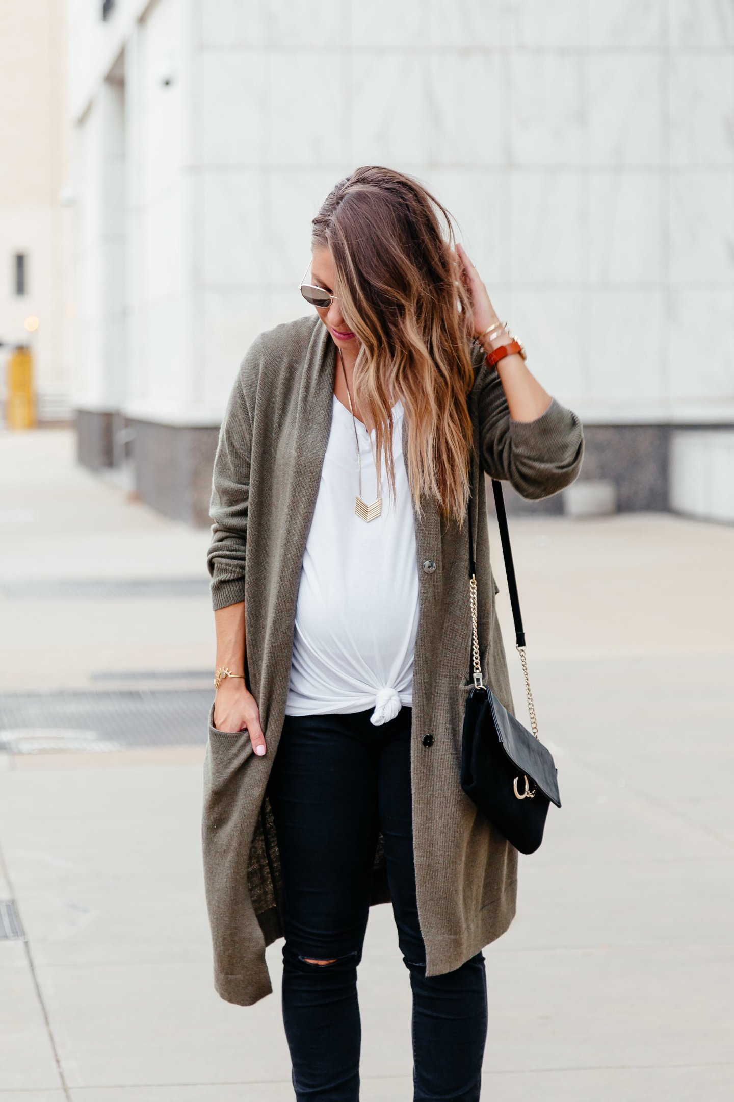 olive cardigan with white tee and jeans