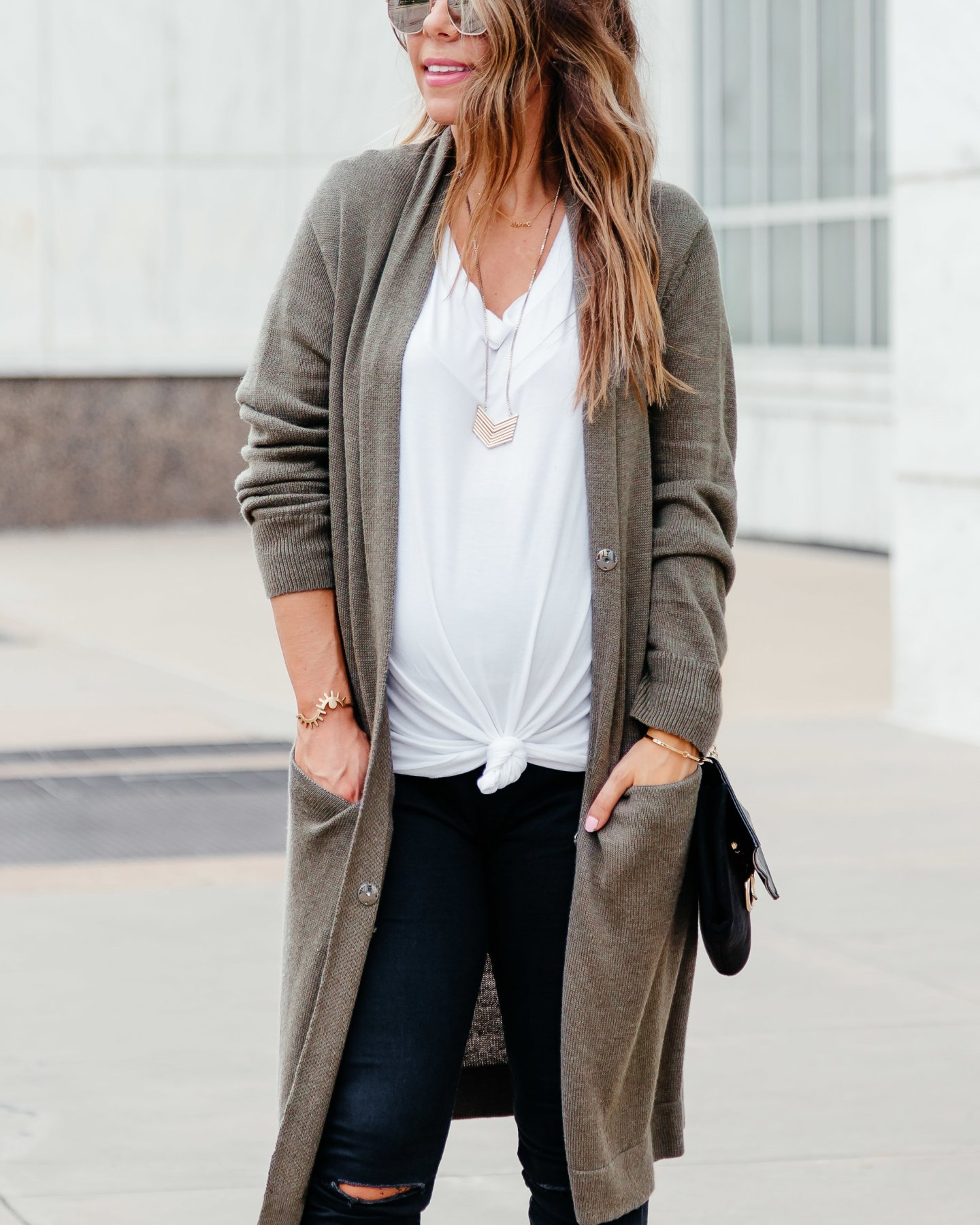 blogger wearing white tee with olive cardigan