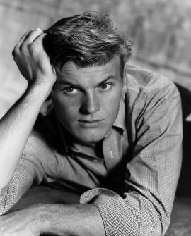 A black & white portrait of Tab Hunter