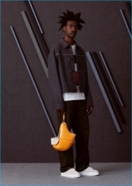 Boyd wears boxy wool jacket Maison Margiela, printed t-shirt Marni, oversized jeans Gosha Rubchinskiy, and sneakers EYTYS.