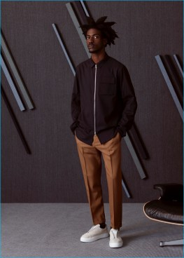 Boyd wears shirt jacket OAMC, wool pleated trousers Marni, and sneakers EYTYS.