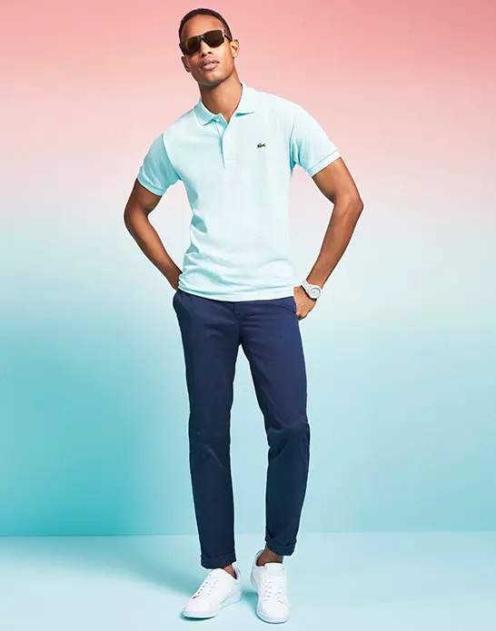 ab169f7f4 Model Conrad Bromfield wears a Lacoste polo shirt.