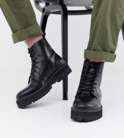 4daf7d131e9e ASOS DESIGN black lace up boots in faux leather with raised chunky sole -  Black
