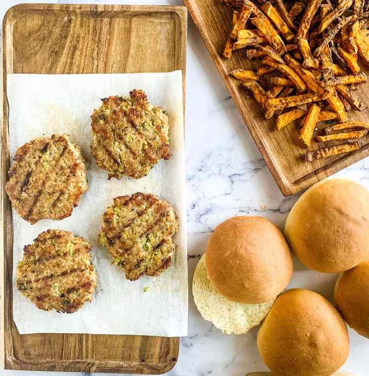 ground turkey burgers and homemade buns ready to serve