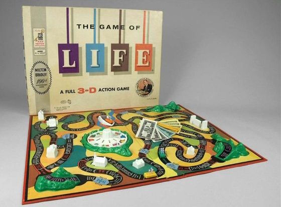 """The Game of Life board game 1960  In The Game of Life, players work their ways around a """"3-D"""" game board that replicates life's journey through adulthood. Fortunes are made and lost; players face success, failure, and revenge. The objective of the game is to be the first to complete the life course. Here the player chooses to retire to Millionaire Acres or gamble at being a millionaire tycoon--the automatic winner of the game. Famed game designer Reuben Klamer designed the game for Milton Bradley. To promote the game, Milton Bradley sought and gained the endorsement of radio and television personalilty Art Linkletter. At least one version of the 1960 game box also featured the slogan """"Milton Bradley 100th Anniversary Game.""""  ManufacturerMilton Bradley Company Materialprinted cardboard 