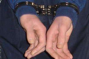 person in handcuffs
