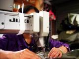 woman sewing machine supply chain human rights