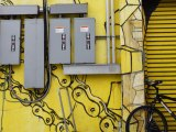 electricity box yellow wall