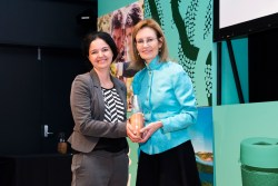 Davina Rooney accepting the 10-year Sustainability Achievement Award on behalf of Stockland from environment minister Gabrielle Upton