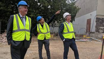 Richard Wynne at construction site with two men