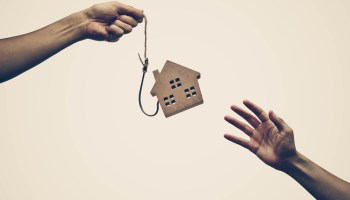 A house on a fish hook / Risks and negative sides of buying a house concept