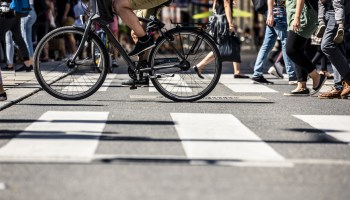 People on pedestrian crossings, on foot and by bicycle