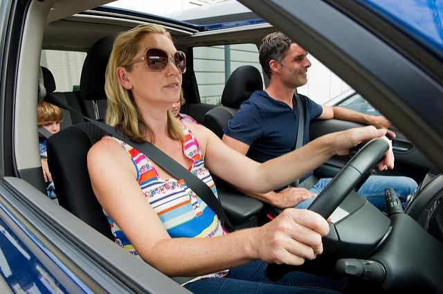 start saving on family transport - family driving in car image