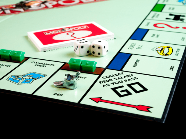 Teaching Kids The Money Game - monopoly board game image