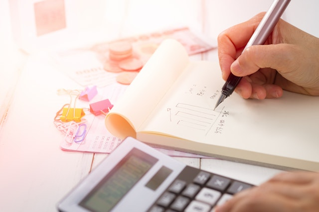 Hiring a Tax Preparer? Don't Proceed Without Asking These 7 Questions First - tax return image