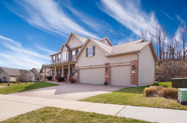 Making The Process Of Moving House As Cost-Effective As Possible - white suburban house image