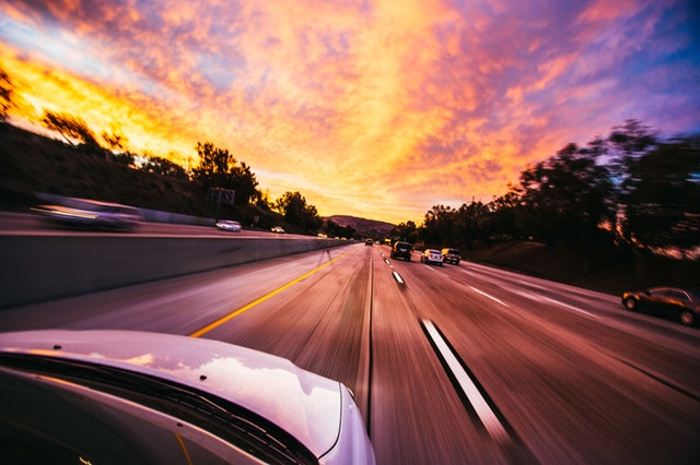 How to purchase your first vehicle - Leave The Costs Behind You On The Road - driving on the highway image