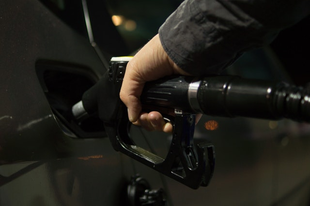 How to purchase your first vehicle - Leave The Costs Behind You On The Road - filling up at a petrol pump image