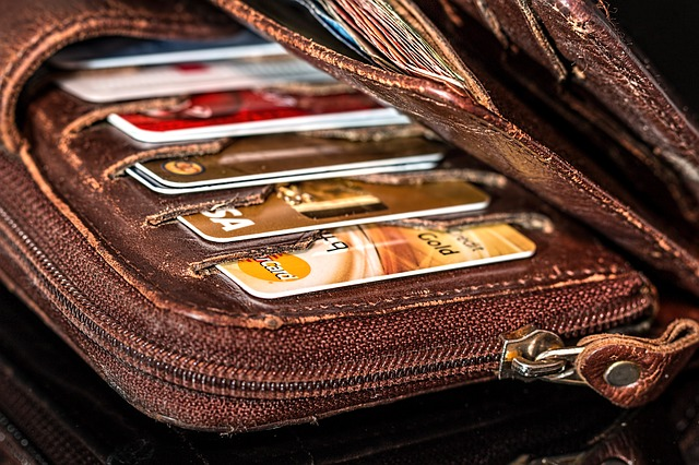 Changing Your Relationship With Debt - credit cards and wallet image
