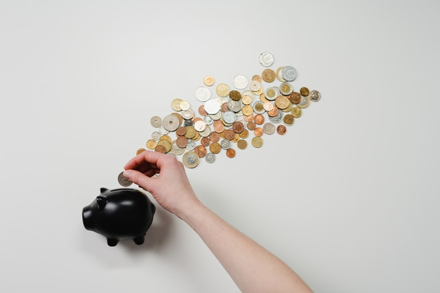 4 Smart Ways To Save Money You Haven't Considered - saving money coins image