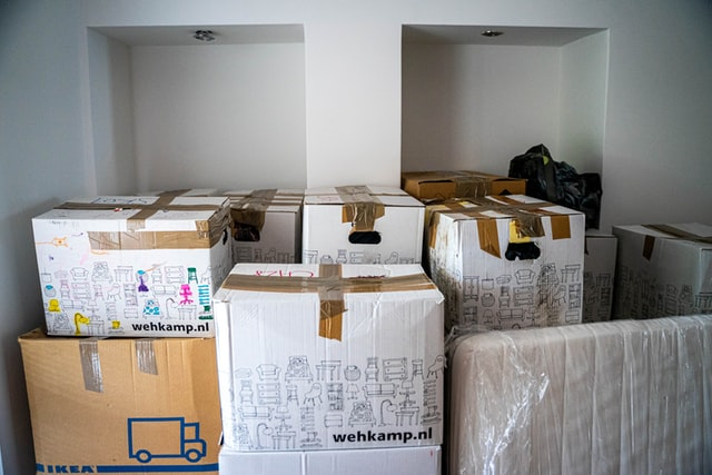4 Imperative Things To Consider Before Moving Home - packing boxes image