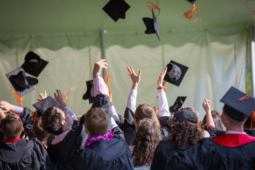 Students celebrating graduating from the CFA