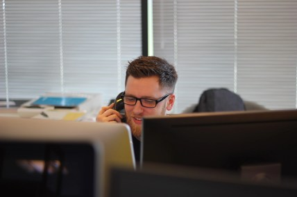 A person receiving a telephone scam call