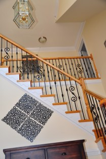 wrought-iron-balusters-on-wooden-stairs