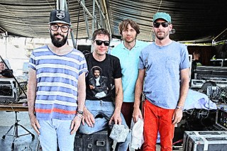 LAS VEGAS, NV - OCTOBER 25: (L-R) Musicians Tim Nordwind, Damian Kulash, Andy Ross and Dan Konopka of OK Go pose backstage during day 2 of the 2014 Life is Beautiful festival on October 25, 2014 in Las Vegas, Nevada. (Photo by FilmMagic/FilmMagic)
