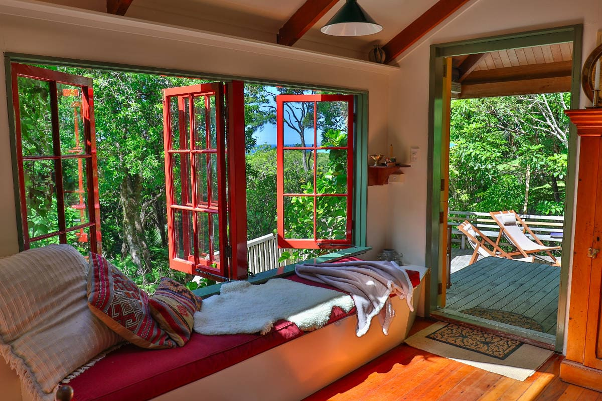 Want to sleep in a tree house? Look no further than Top Hut in the Coromandel Peninsula. Surrounded by bush and birds, this is the perfect weekend getaway. Read more at www.thefivefoottraveler.com
