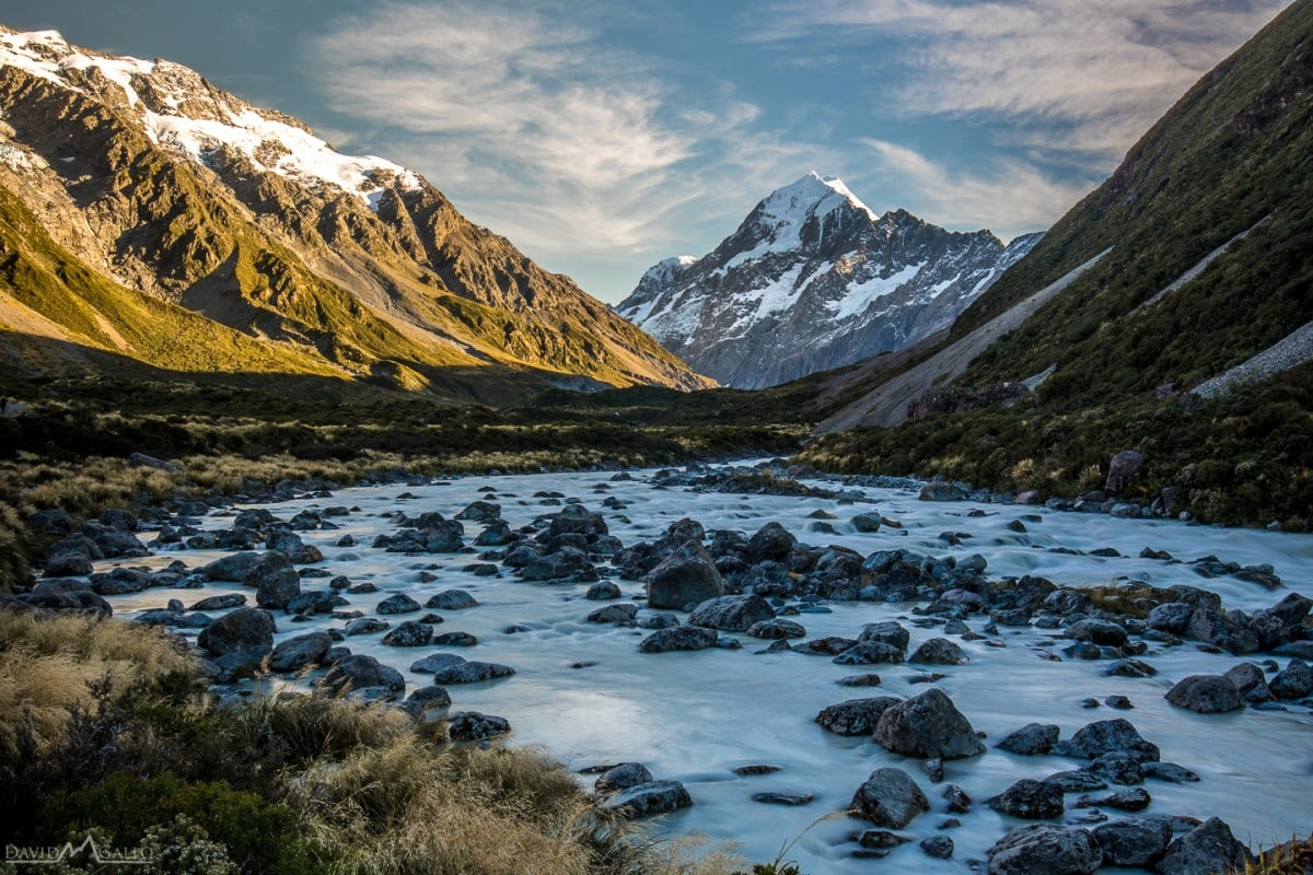 rushing water leads to mount cook in all of its glory at golden hour