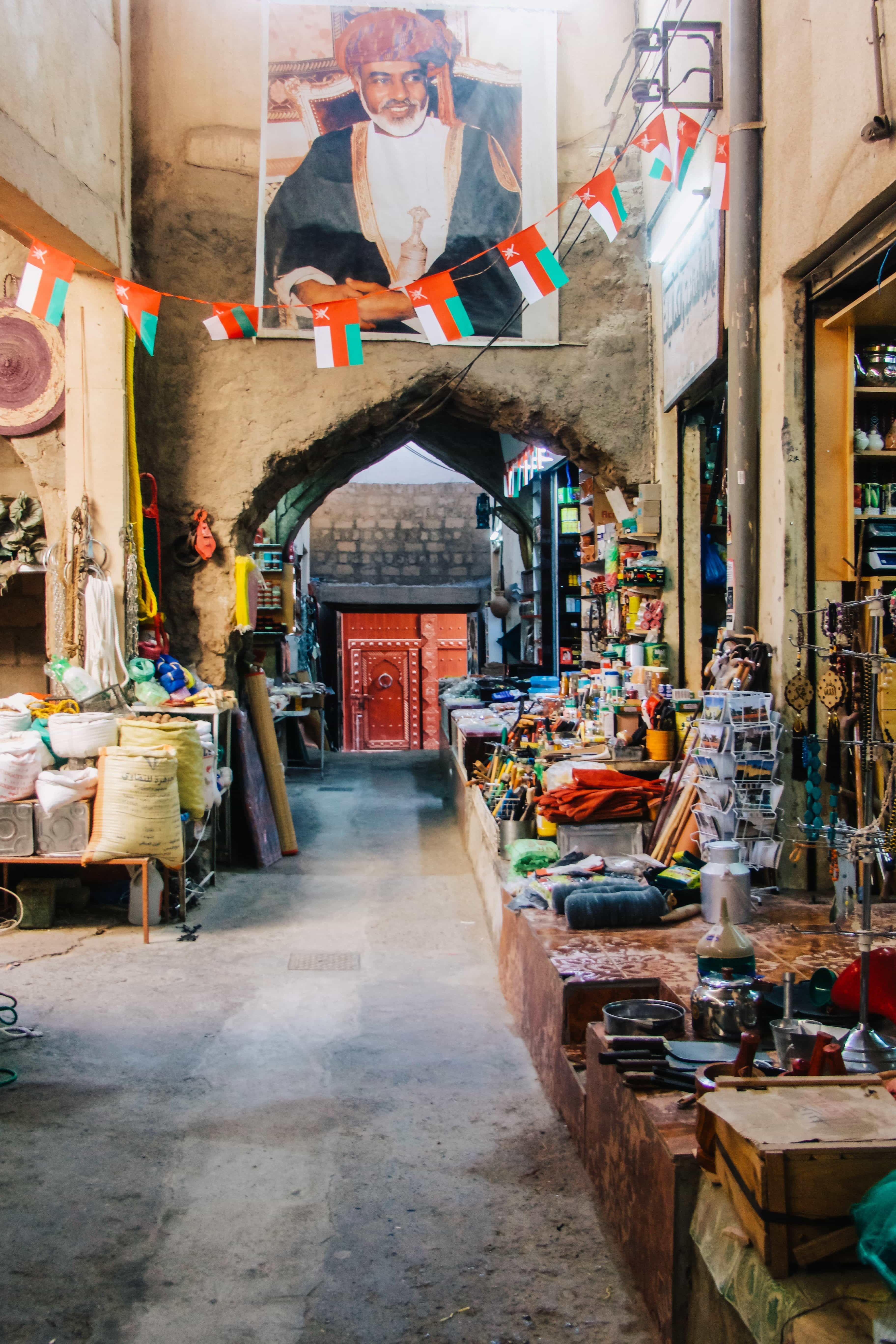 the colorful passageways of a souq in oman