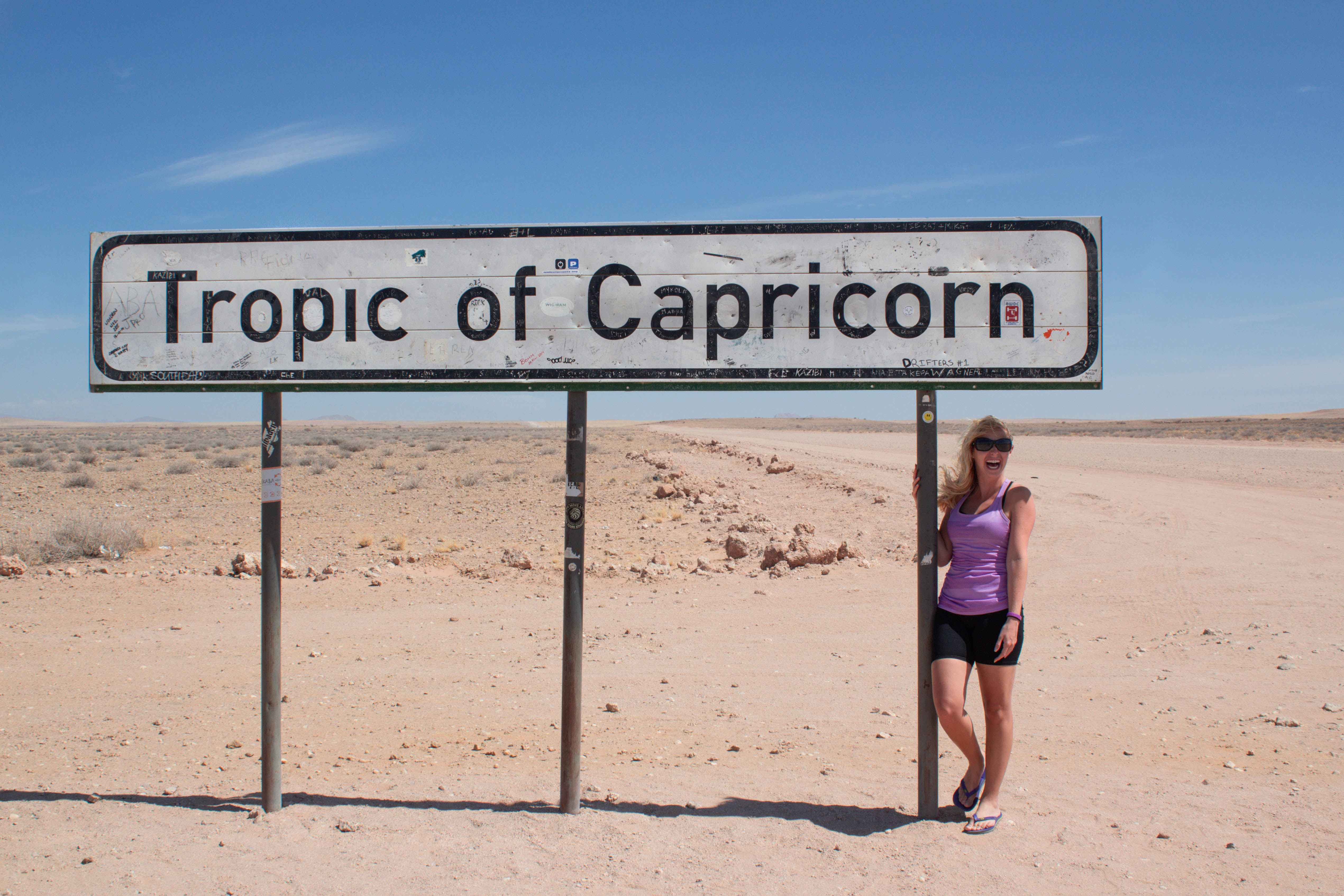 girl stands under tropic of capricorn sign
