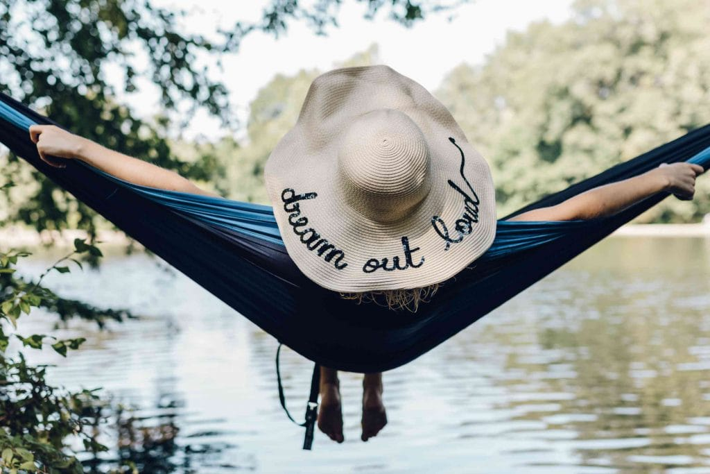 girl in hammock by the lake