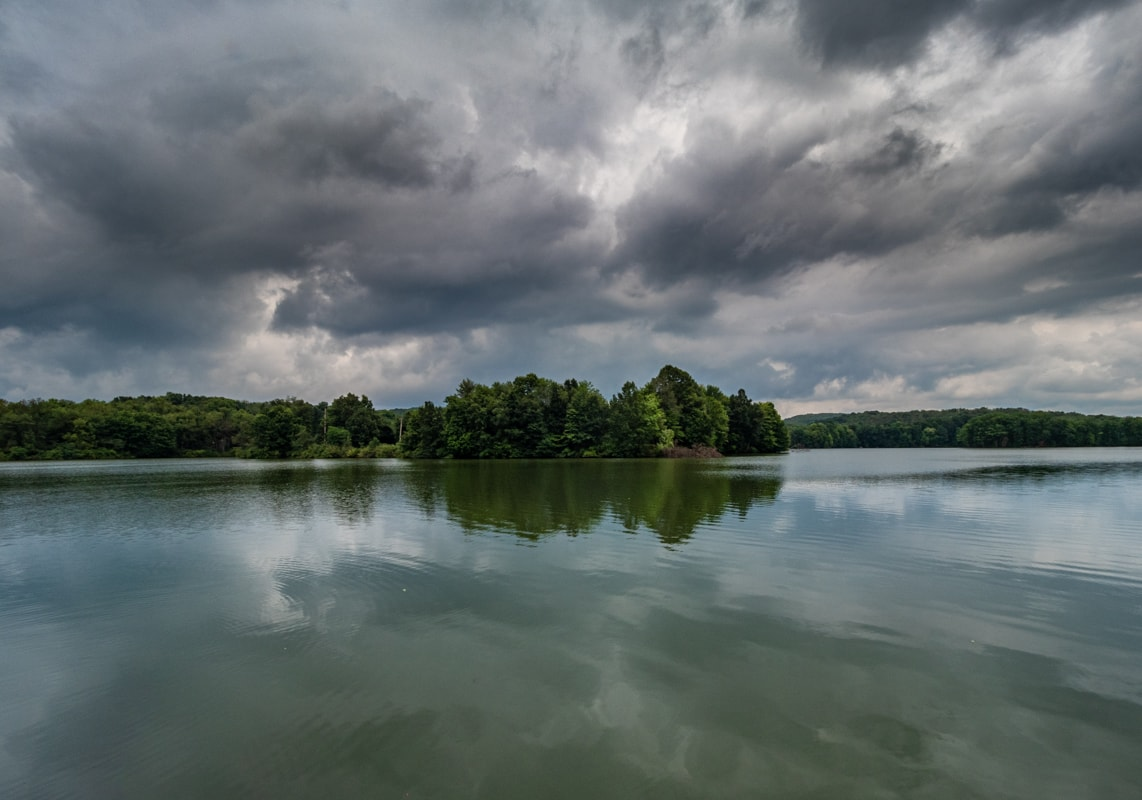 beautiful reflections on a lake in moraine state park, butler county