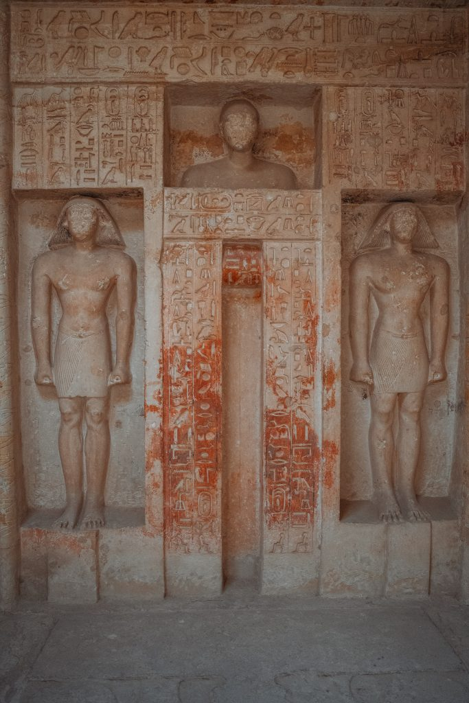 a tomb with some color at the necropolis of saqqara - seen when visiting the pyramids