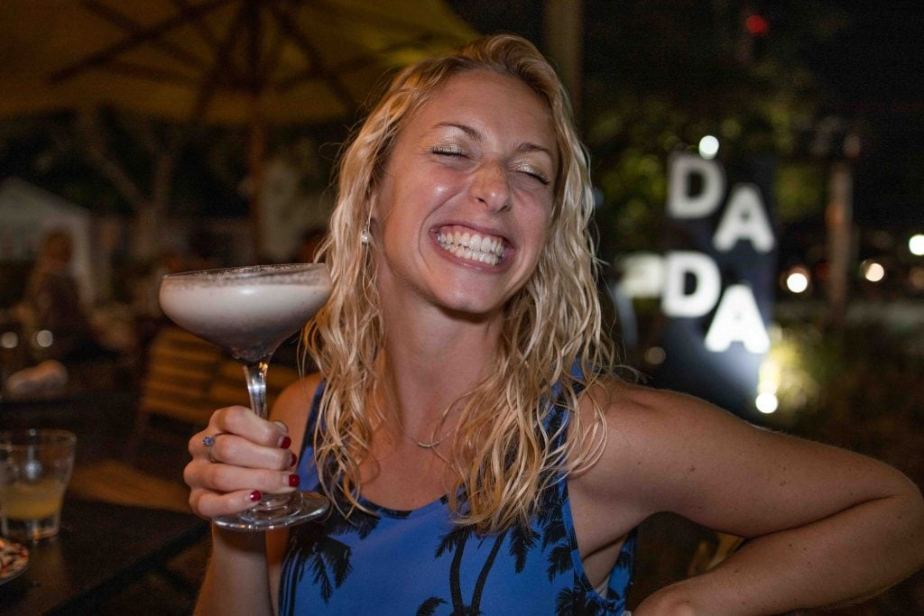 a girl holding up an oreo martini at dada in delray