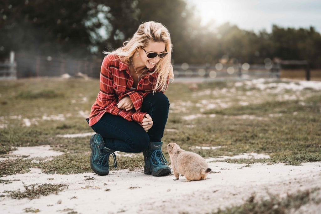 a girl with a prairie dog on her way into the badlands
