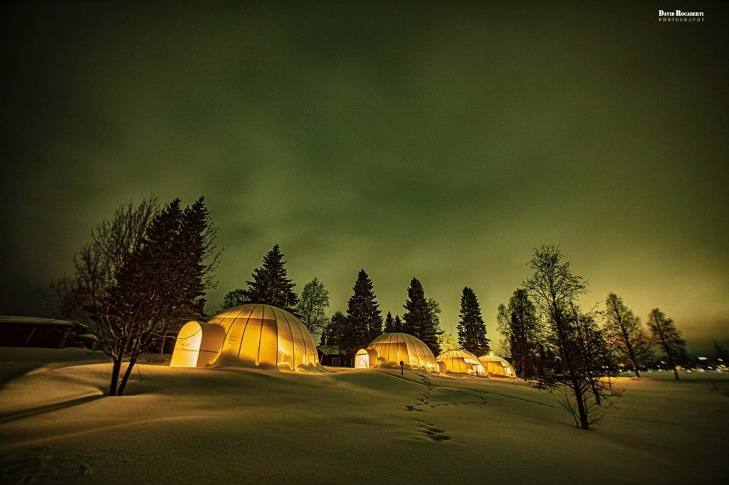 igloos in lapland with the northern lights
