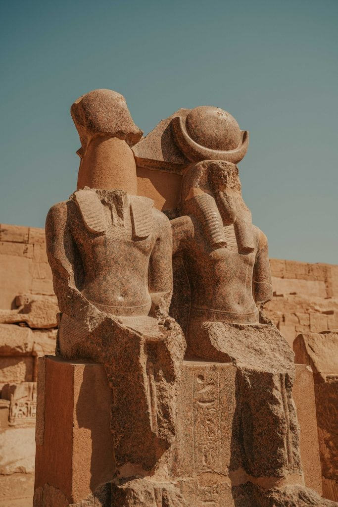 statues at habu temple luxor