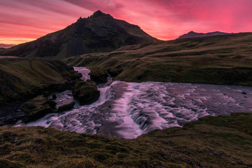 a stunning pink sunset atop skogafoss on my iceland holidays