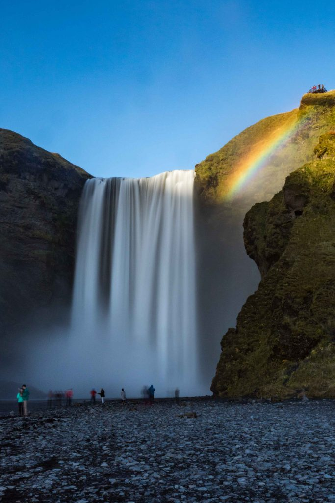 skogafoss waterfall in iceland with a rainbow