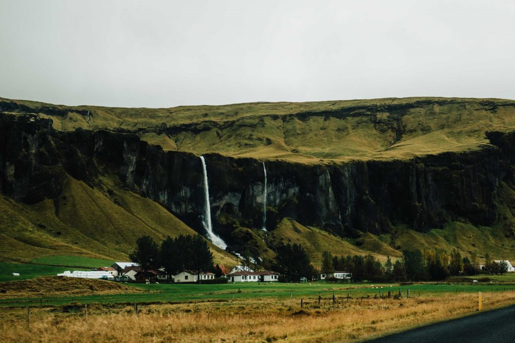 mountain and waterfall backdrop to our iceland accommodation