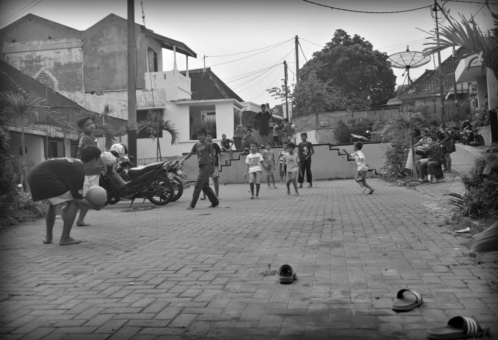 Boys playing football in the side streets of Malang
