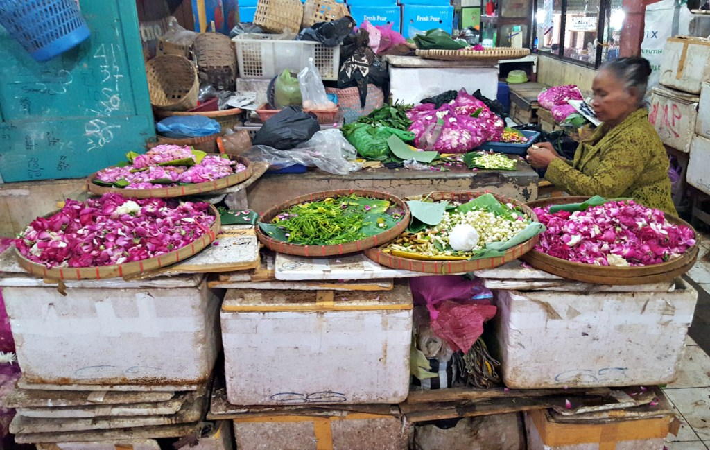 Stringing flowers at Solo's wet market