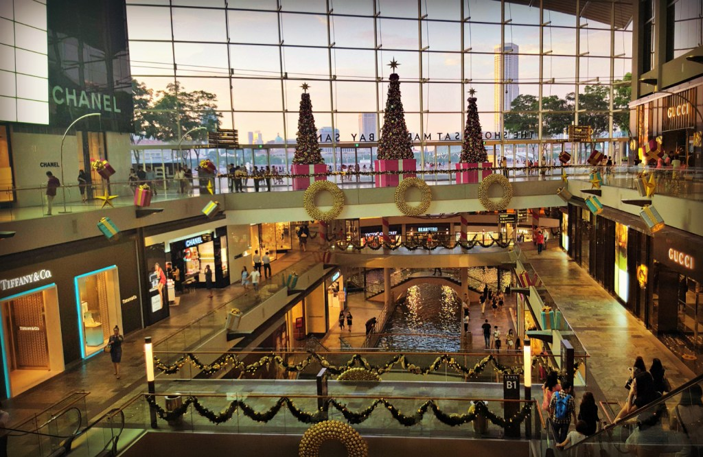 """Nothing says Christmas like a designer shopping mall with a boating lake in the basement, unironically called """"The Shoppes"""""""