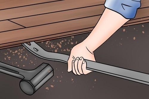 Installing Hardwood Floor with Help of Crowbar