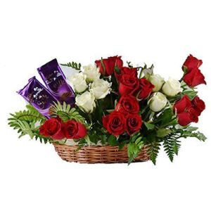 The FloralMart® Mother's Day Special Fresh Flowers Premium Basket Arrangement of 15 Red Roses, 8 White Roses & 02 Small Packet Branded Chocolate