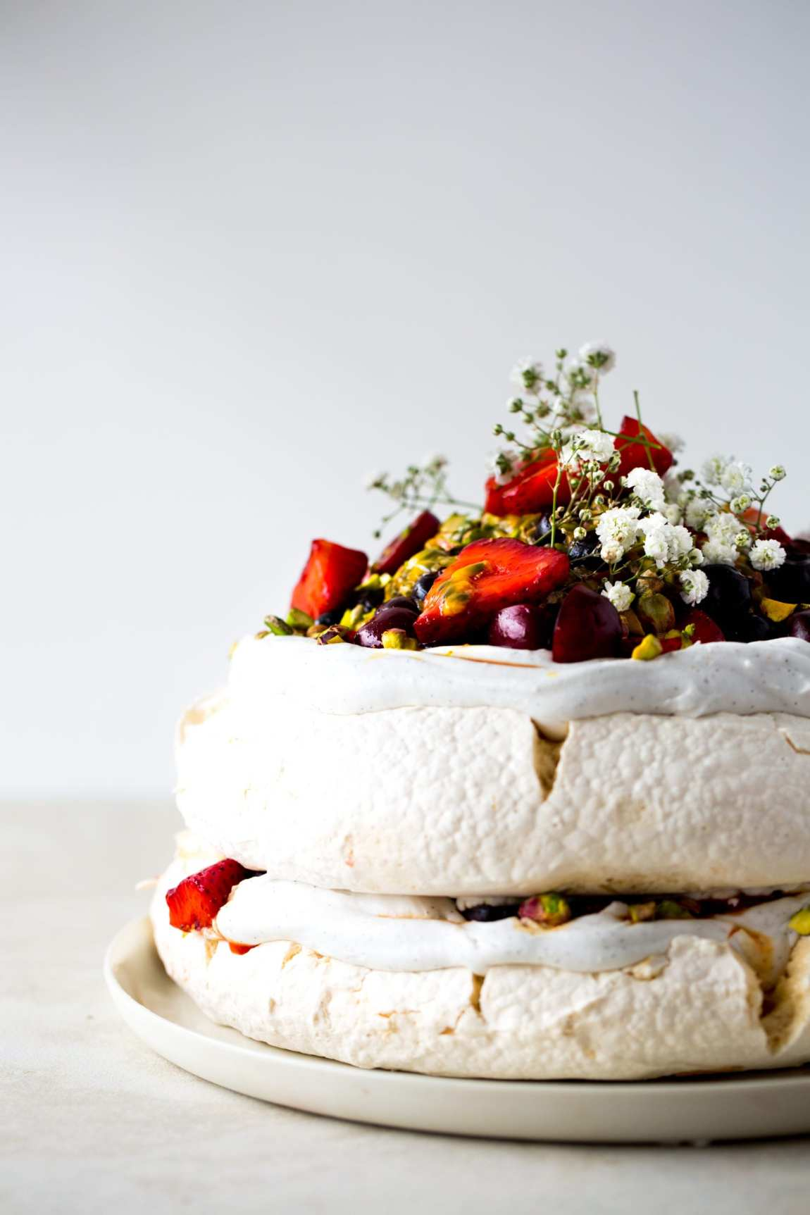 Vegan Pavlova with Saffron Berries, Passionfruit & Pistachio | The Floured Kitchen