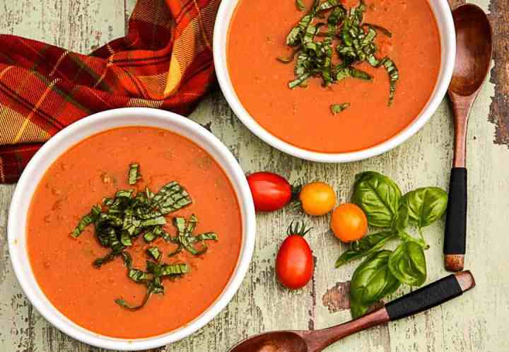Two bowls of soup, with Tomatoes